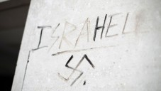 Graffiti saying 'Israhell' next to a swastika on a wall in Victoria, London. T  Photo credit: Yui Mok/PA Wire