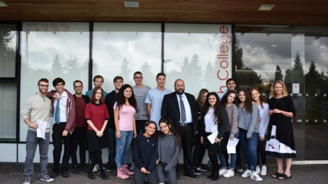 Yavneh College students celebrating their results with staff members