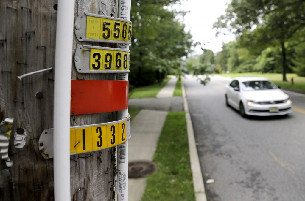 In this Saturday, Aug. 5, 2017, photo, polyvinyl chloride piping is seen on an utility pole on Airmount Road in Mahwah, New Jersey. (AP Photo/Julio Cortez)
