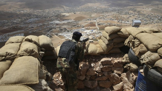A Lebanese army soldier takes up a position overlooking an area controlled by the Islamic State group at the edge of the town of Arsal, in northeast Lebanon, June 19, 2016. (AP/Hussein Malla)