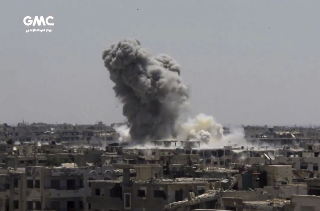 This frame grab from video provided on Sunday, Aug. 13, 2017, by the Ghouta Media Center, a Syrian activist media group, shows smoke and debris rising after Syrian government ground-to-ground rocketa strike the opposition-held town of Ain Terma, in the Eastern Ghouta suburb of Damascus, Syria on Saturday. (Ghouta Media Center, via AP)
