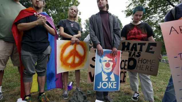 "Counterprotesters wait for the start of a planned ""Free Speech"" rally on Boston Common, Saturday, Aug. 19, 2017, in Boston. (AP Photo/Michael Dwyer)"