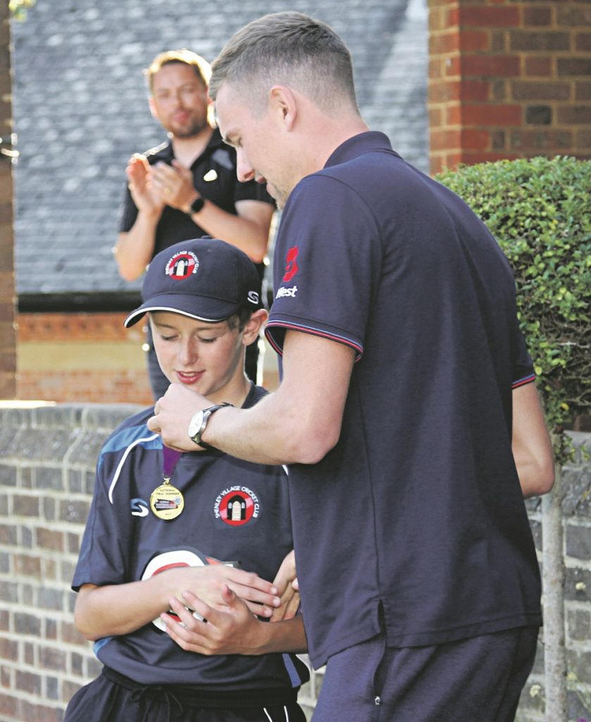 Ben receiving his medal from England fast bowler Jake Ball
