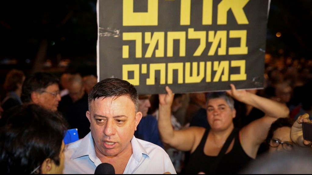 Labor leader Avi Gabbay attends the weekly protest against Attorney General Avichai Mandelblit outside Mandelblit's home in Petah Tikva on July 15, 2017. (Flash90)
