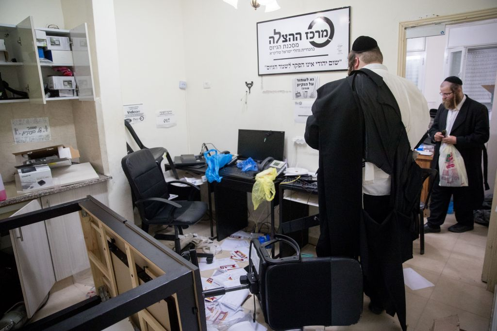 An ultra-Orthodox man seen in an anti-draft office in the Mea Shearim neighborhood after a police raid, on August 8, 2017. (Yonatan Sindel/Flash90)