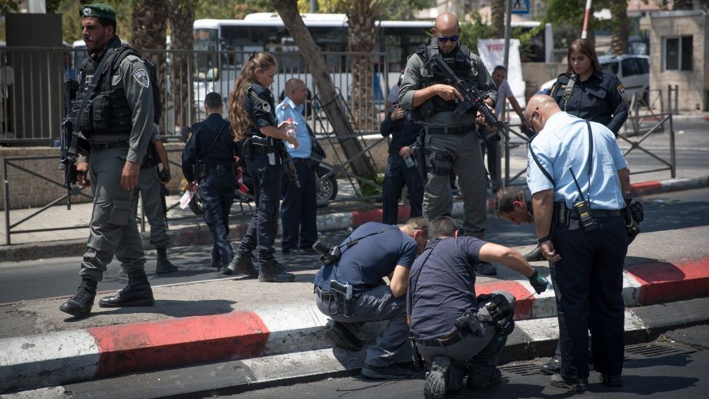 Police officers are at the scene of a stabbing attack near Damascus Gate of Jerusalem's Old City