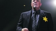 Billy Joel wearing a yellow Star of David
