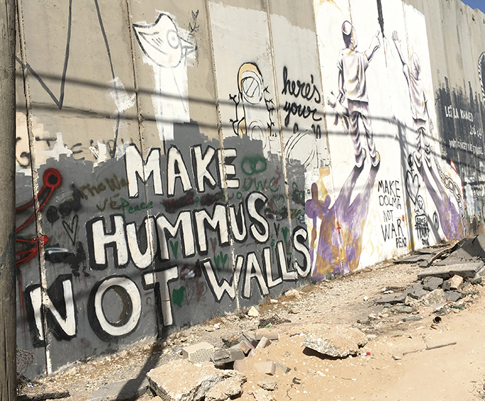 Sections of the wall dividing Israel and the West Bank are covered with graffiti.