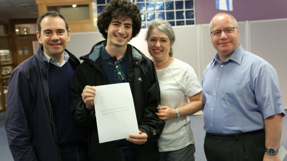 Adam Lang (2nd left) and parents and Mr Appleman (Headteacher)