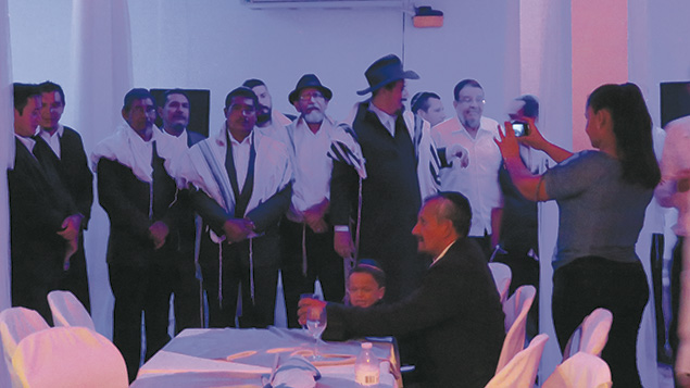 Nicaraguan men who converted to Judaism wait for their brides before a traditional Jewish wedding for the 22 couples on July 23.