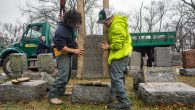 Workers placing headstones back