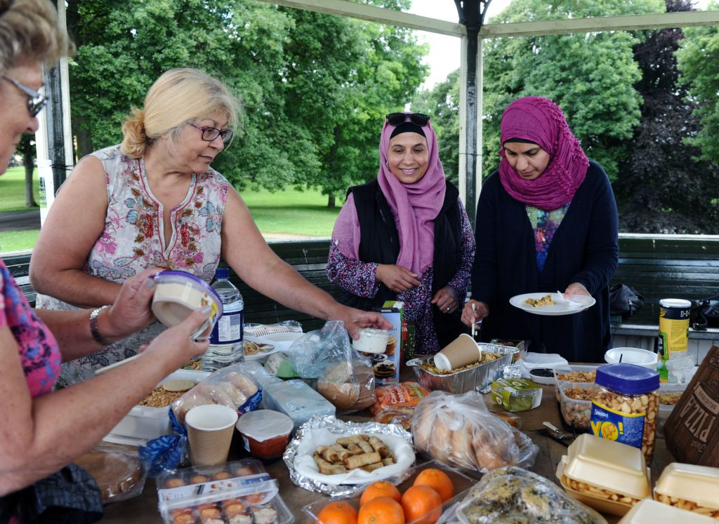 Jewish and Muslim women get stuck into the picnic, as they forge new friendships (photo credit: Yorkshire Evening Post)
