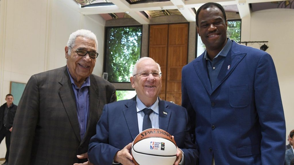 President Reuven Rivlin (C) meets with former NBA players David Robinson (R)