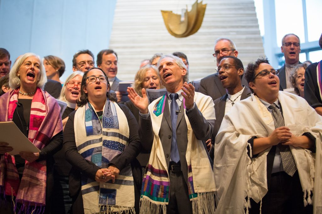Interfaith leaders gather at Boston's Temple Israel on August 17, 2017, for a vigil against bigotry and racism (Elan Kawesch/The Times of Israel)