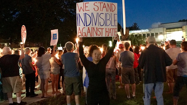 Candles burn brightly at the vigil at the Municipal Green in Teaneck on Sunday.