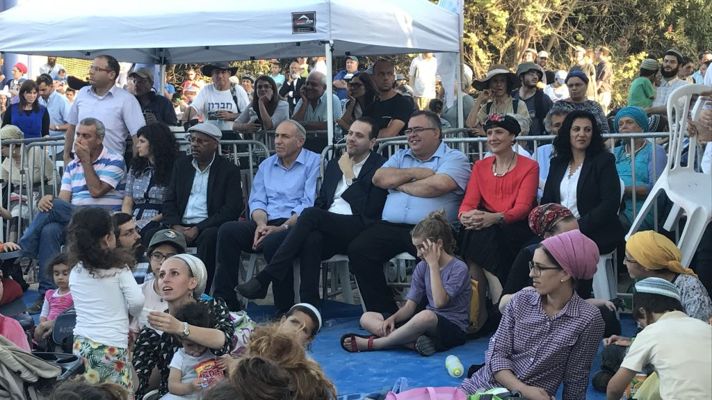 Likud and Jewish Home lawmakers at a ceremony at the evacuated Sa-nur settlement in the northern West Bank. (Jacob Magid/The Times of Israel)