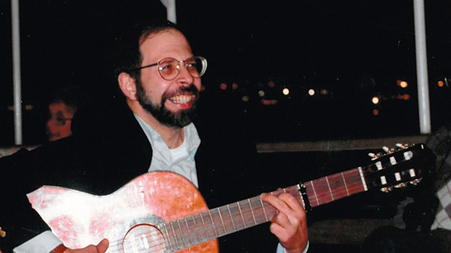 A younger Rabbi Goldin plays guitar.