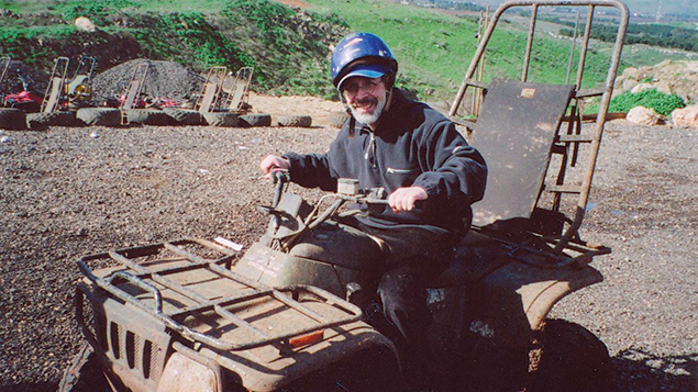 In Israel, Rabbi Goldin tries out some farm equipment.