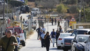Israeli security deploys at an entrance to Har Adar settlement near Jerusalem, Tuesday, Sept. 26, 2017. Israeli police said that a Palestinian attacker opened fire at the entrance to the settlement killing three Israeli men and critically wounding a fourth. (AP Photo/Mahmoud Illean)