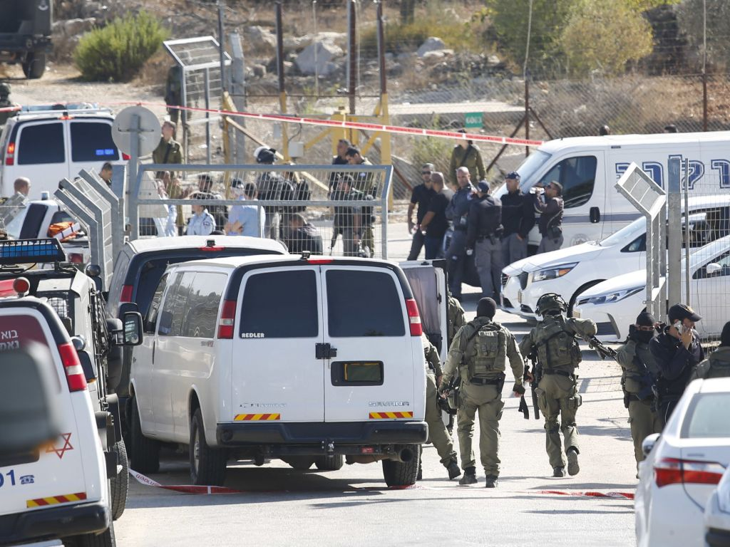 Israeli security deploys at an entrance to Har Adar settlement near Jerusalem after a Palestinian assailant opened fire killing three Israeli men and critically wounding a fourth