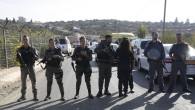 Israeli police blocks the road to Har Adar settlement near Jerusalem after a Palestinian attacker opened fire at the entrance to the settlement killing three Israeli men and critically wounding a fourth. (AP Photo/Mahmoud Illean)