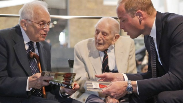 The Duke of Cambridge (right) meets Freddie Knoller (left)  during a visit to the Imperial War Museum in London.. Centre is John Harrison.    Photo credit: Frank Augstein/PA Wire