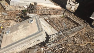 Picture of topped headstones, as reported by the Shalom group