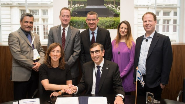 Signing the memorandum of understanding.   Back left-right: Nathan Tor of the Embassy of Israel, UK Ambassador to Israel David Quarrey, Israeli envoy to Britain Mark Regev, Paloma Cid of IET , Hugo Bieber, Chief Executive, UK Israel Business. Front: Karin Mayer-Rubinstein (IATI) and Nigel Fine (IET)  Photo credit: Blake Ezra Photography