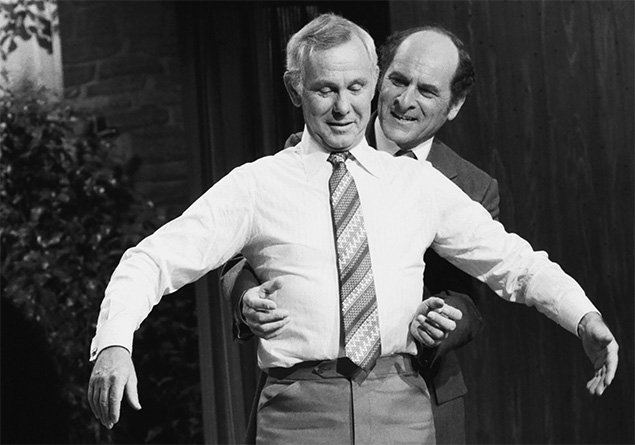 Dr. Henry Heimlich demonstrates his famous eponymous maneuver to Johnny Carson on April 4, 1979. (Gene Arias/NBCU Photo Bank)