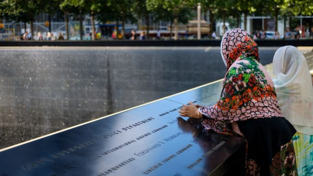 Visitors pause at the National September 11 Memorial in New York City on September 8, 2017 as NYC prepared to mark the 16th anniversary of the September 11th terrorist attacks. Getty Images
