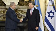 Israeli Prime Minister Benjamin Netanyahu (L) shakes hands with Argentina's President Mauricio Macri