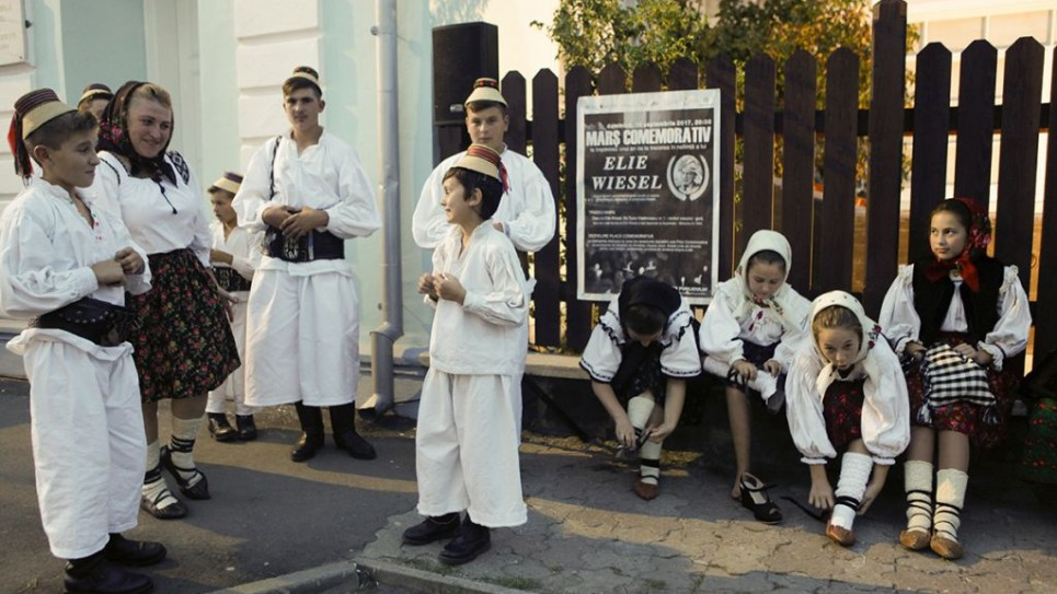 Young citizens of Sighet prepare for the march in Elie Wiesel's honour