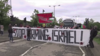 Protesters hold banners and shout 'stop arming Israel' at the demonstration