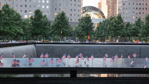 Small American flags are placed in all 2,983 names on the 9/11 Memorial on July 4, 2017 ahead of September 11th commemoration ceremonies. The flag placement has become an annual tradition at the site on July 4.
