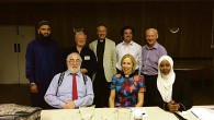 Imam Shakeel Begg is first on the left at the back, pictured at Catford and Bromley with other faith leaders