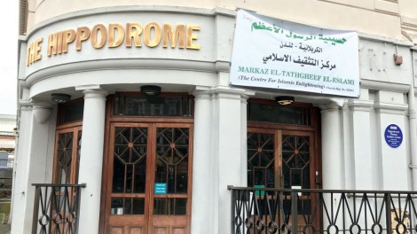 Golders Green Hippodrome with a banner above the entrance, describing its new owners