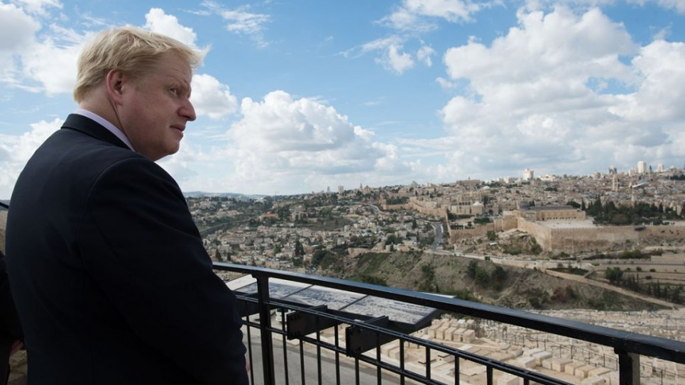 Boris Johnson looks out over the Old City of Jerusalem from the Mount of Olives during his trade visit to Israel (2015).   Photo credit: Stefan Rousseau/PA Wire