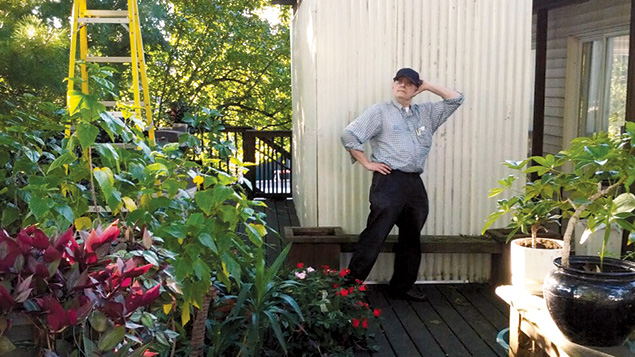 Jack Flamholz stands in front of his sukkah.