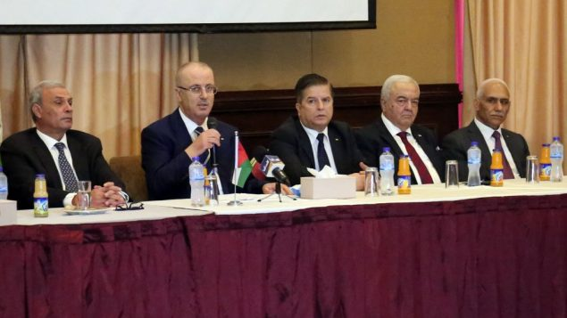Palestinian prime minister Rami Hamdallah (C-L) attends a meeting with members Palestinian political groups, in Gaza city on October 4, 2017. GettyImages