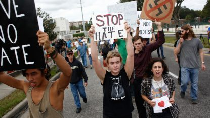 Protesters demonstrate at a speech