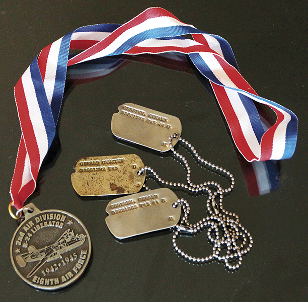 Mr. Gersten's dog tags and a commemorative medal.