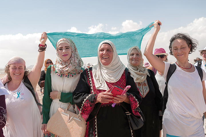 Jewish and Muslim women here are framed by an iconic turquoise scarf.
