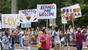Pride refugee signs