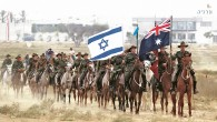 Australian men and women in World War I uniforms recreate the last calvary charge that took place in The Battle of Beersheba   Credit: EPA/JIM HOLLANDER