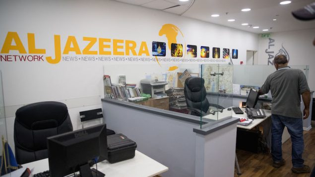 Workers at the Al Jazeera offices in Jerusalem