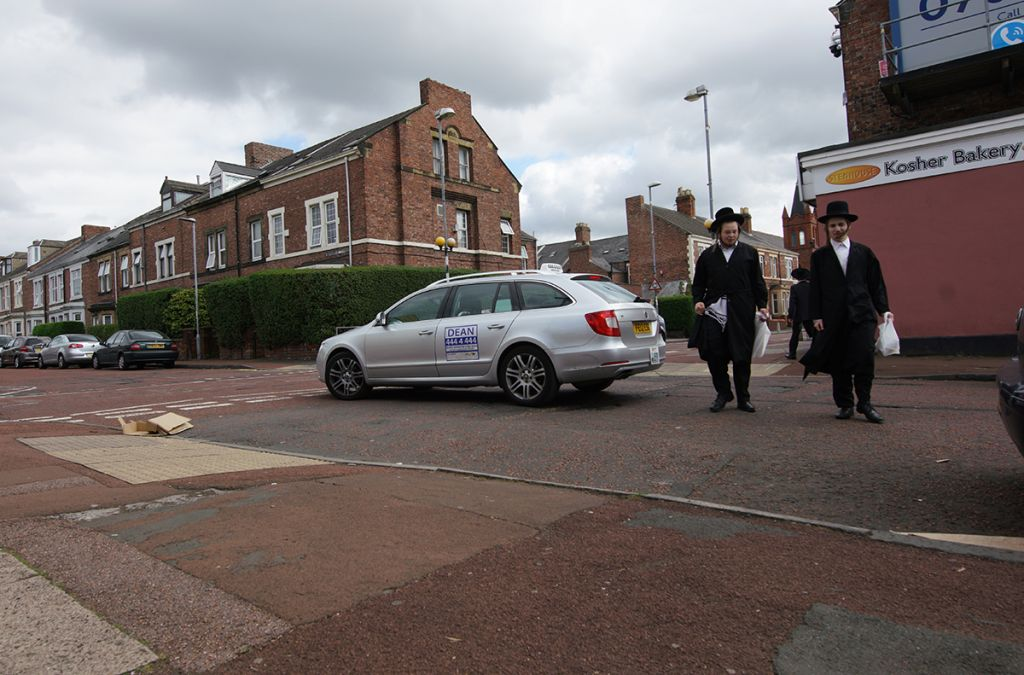 Orthodox Jewish teens crossing the road in Gateshead