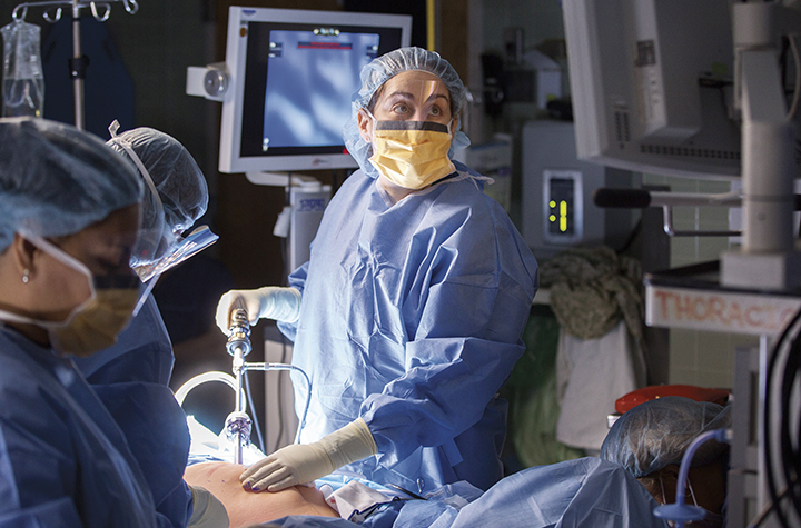 Dr. Sharyn Lewin in the operating room.