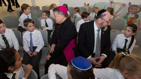 Chief Rabbi Ephraim Mirvis and Bishop John Keenan talk to students at the new school
