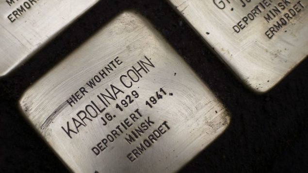 """""""Stolpersteine"""" (stumbling blocks) have been laid for Karolina Cohn and her family at a place where they once lived in Frankfurt, German(AP Photo/Michael Probst)"""