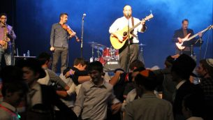 The Eitan Katz Band keeps the young men in front of the AJA stage dancing into the night.